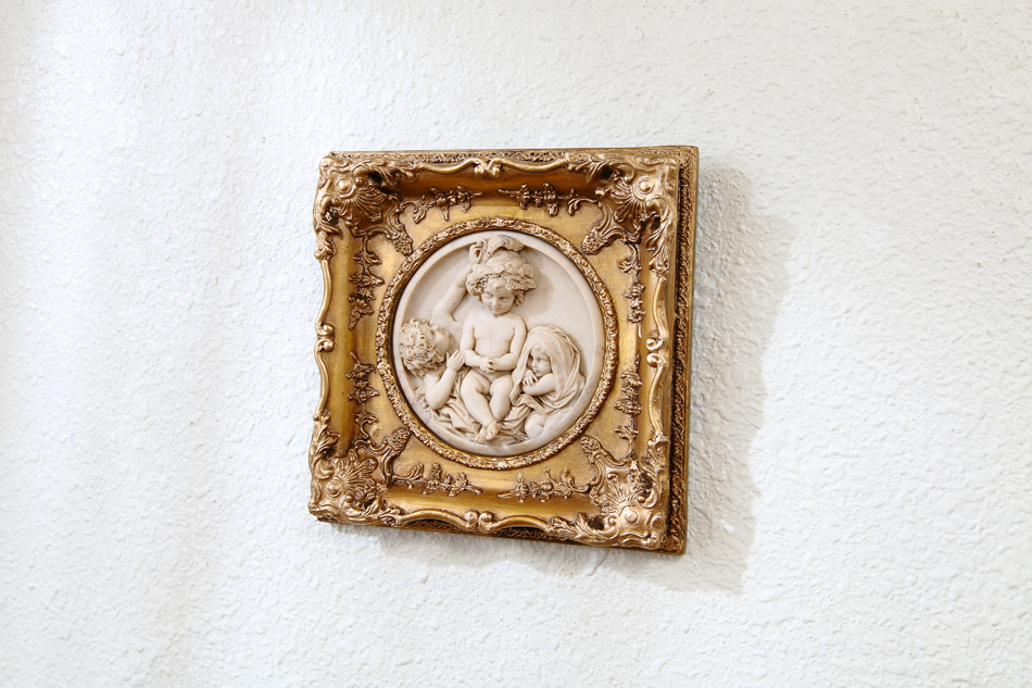 Three cherubs playing / plaque picture